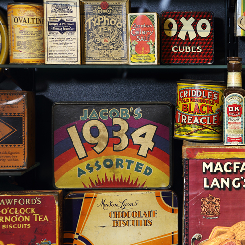 Museum of Brands, 1930s Display of Brands, Oxo, Jacobs and Various Tins